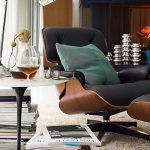 Dark Armchair For Reading With Ottoman And Tulip Side Table