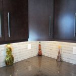 Dark Wooden Kitchen Storage With White Carrara Marble On Backsplash