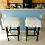 Double White Bar Stool Slipcovers With Blue Kitchen Island And Wooden Kitchen Set