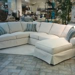 Elegant White Slipcovers For Sectional Couches With Blue Stripped Pillows