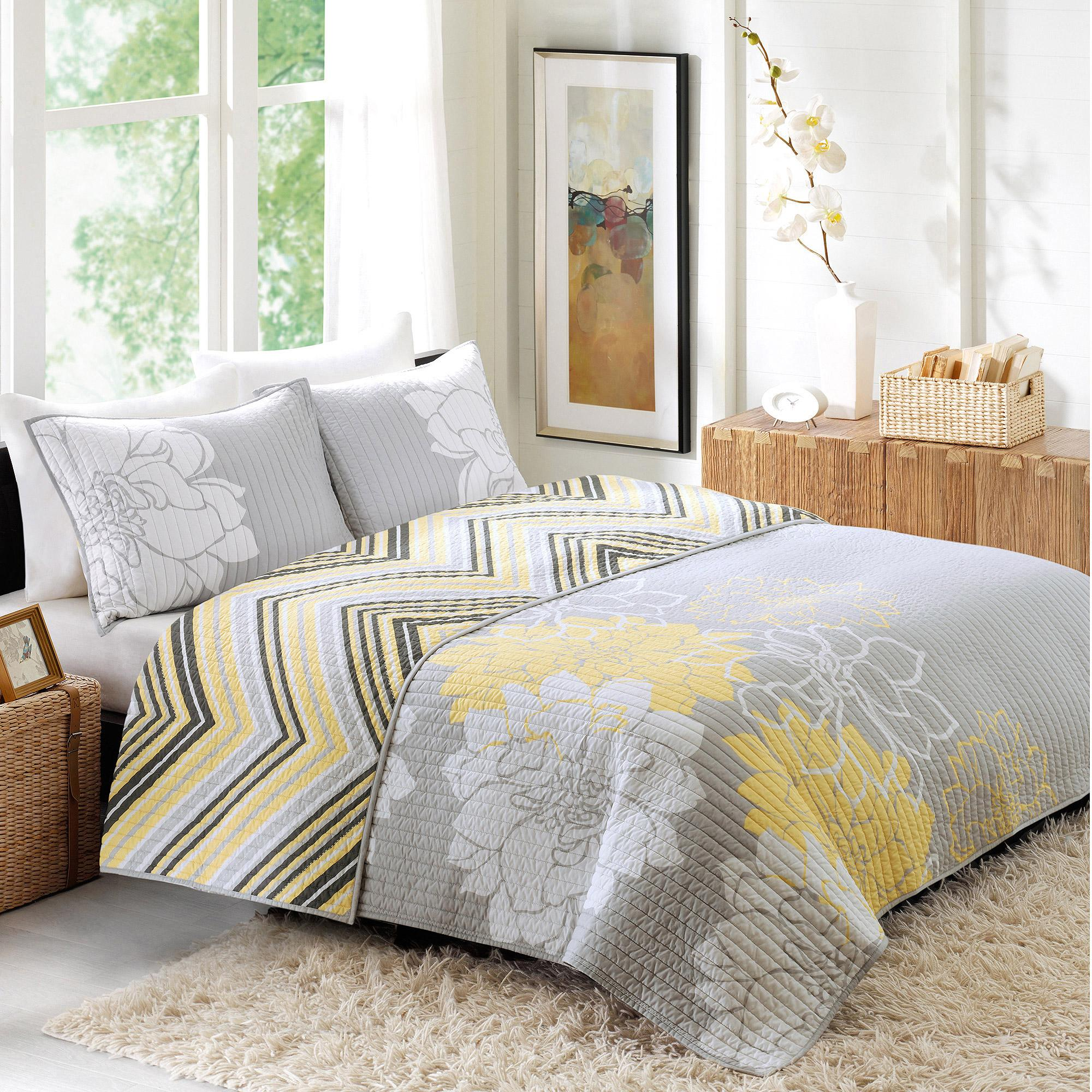 grey and light yellow bedding the image