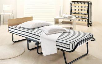 Folding Bed With Striped Mattres And White Pillows Are Perfect For Guest Bed Solution