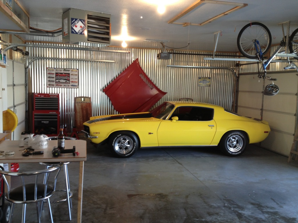 Garage Finishing Ideas With Yellow Car Wooden Table And Bicycle