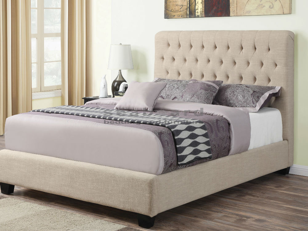 linen tufted of tall upholstered bed on hardwood floor bedroom