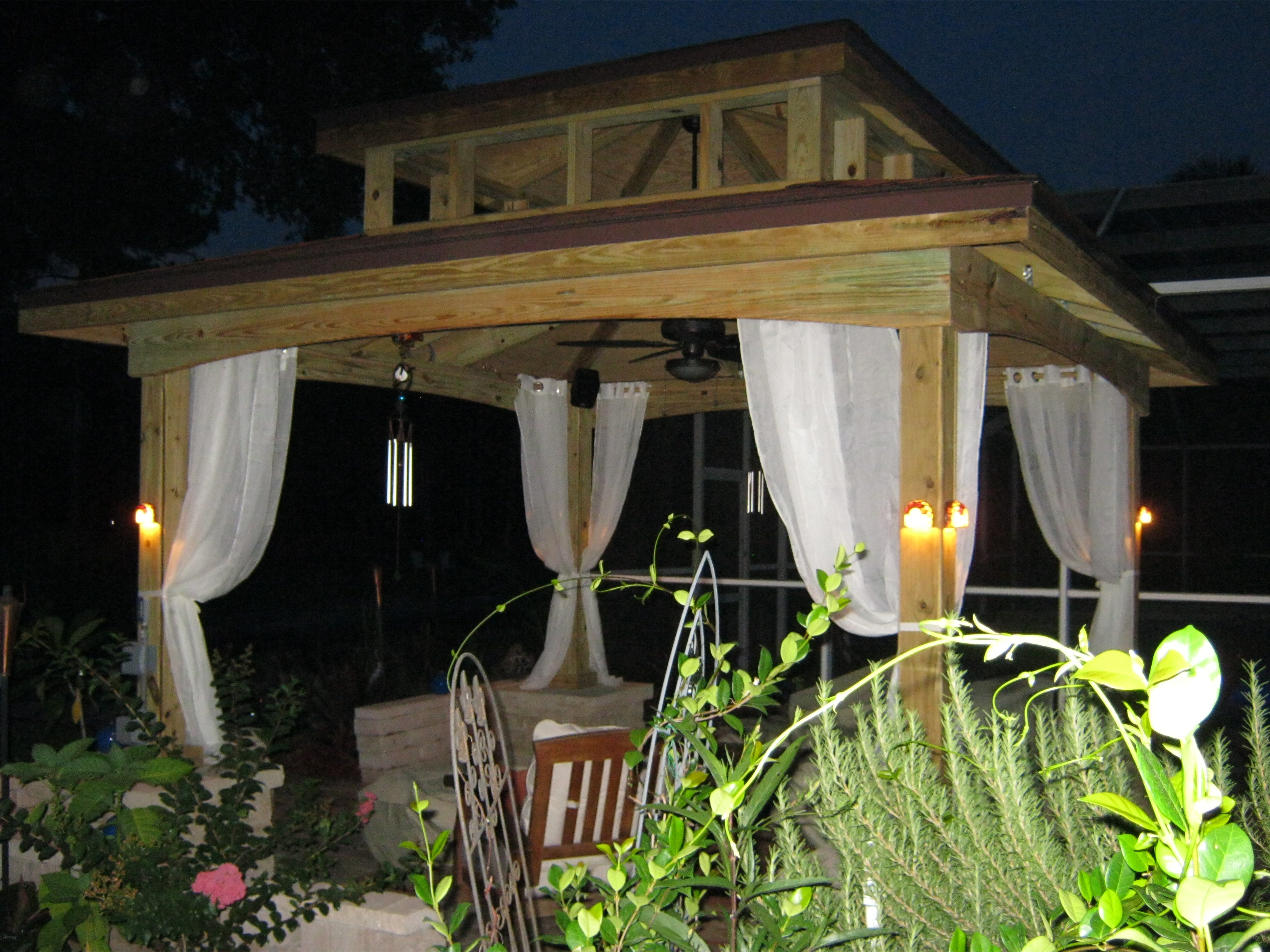 Outdoor Elegant Gazebo With Lighting And White Curtains