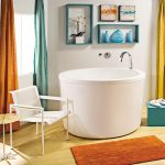 Round White Japanese Soaking Tub Kohler With Blue Shelves White Chair And Colorful Curtains
