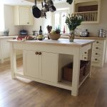 Simple White Stand Alone Kitchen Islands With Double Racks For Baskets And Double Doors