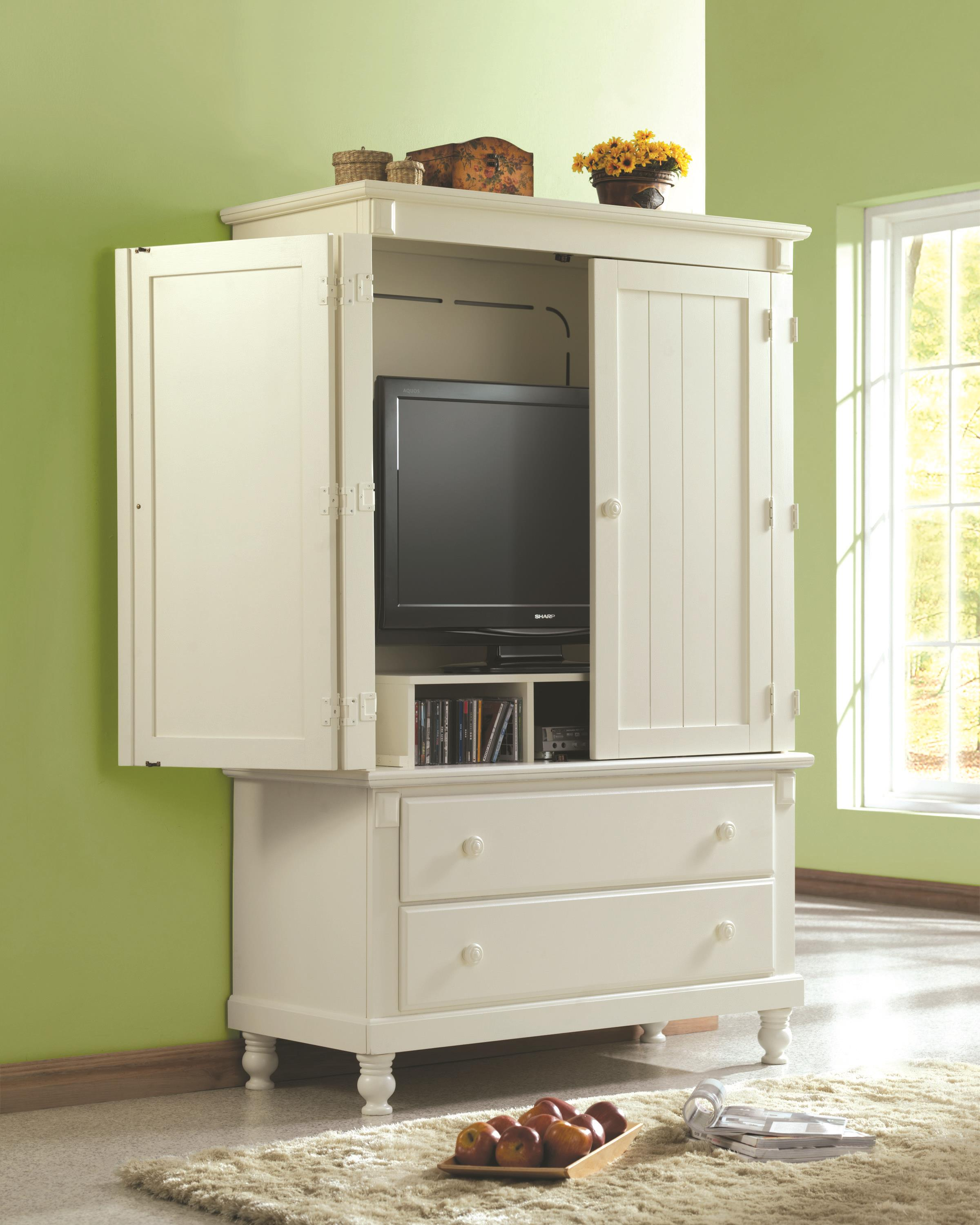 simple white tv hutch with doors and double drawers plus fur rug