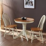 Small Round Oak Table And Two Chair Near Dark Wall Painted And Frame
