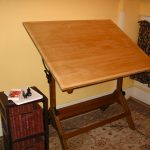 Square Drafting Table Near Shelf And Baskets With Cool Rug And Curtain