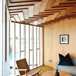Stylish Design Of Wood Ceiling Planks In Living Room With Chair Sofa And Round Table