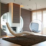 Transparent Bubble Of Chairs That Hang From The Ceiling With Sleeper Chair And Fur Rug
