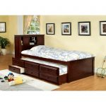 Twin Bed With Drawers Underneath And Rug Plus Frames On Wall