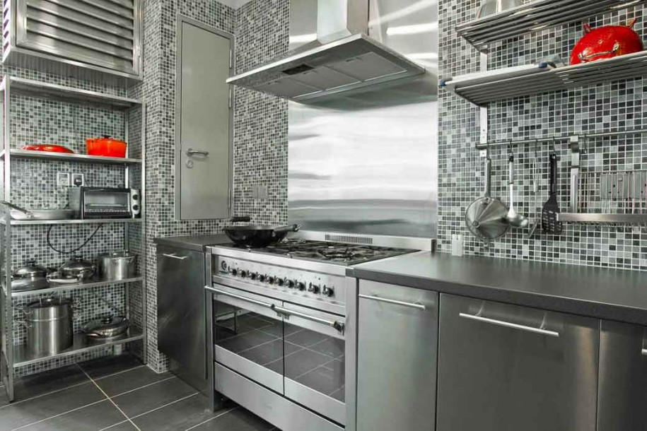 steel backsplash with small tiles wall design and grey steel cabinet