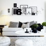White And Black Theme Living Room With Wall Accessories White Sofa Stripes Pillows Standing Lamp Table And Fur RUg