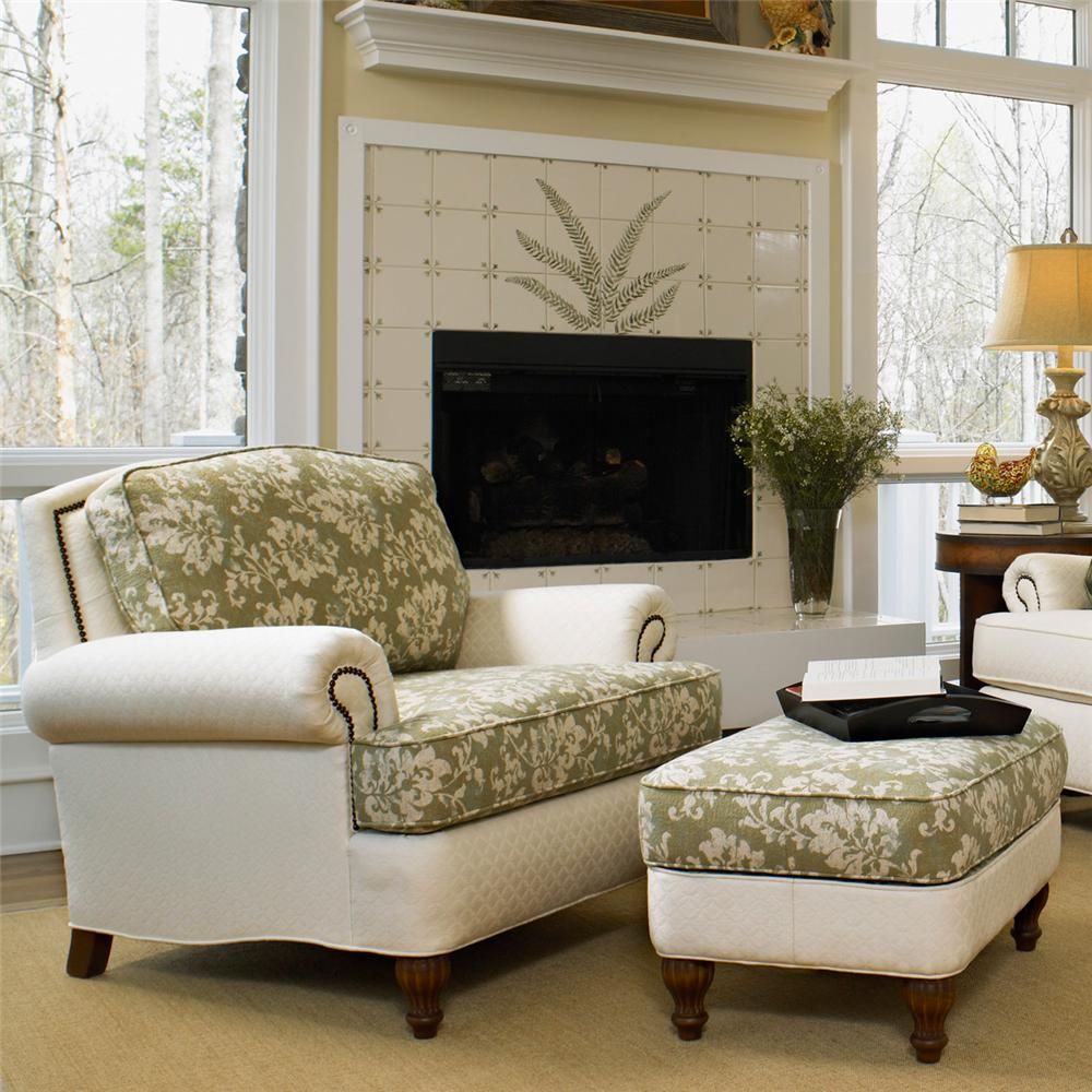 white and green leaves pattern of chairs with ottomans for living room plus fireplace