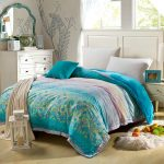 White Bed Frame And Blue Winter Theme Of Duvet Covers