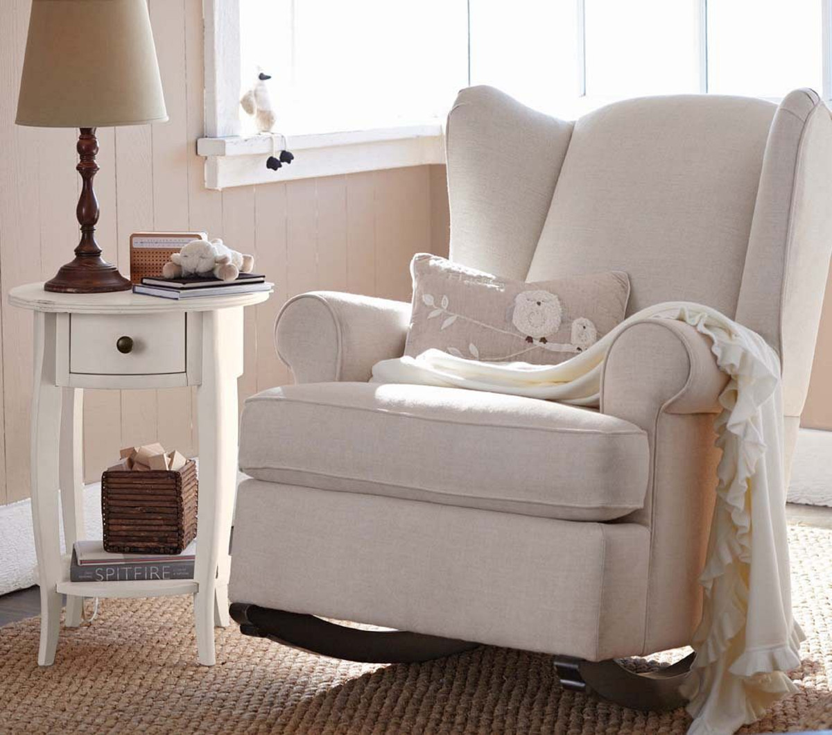 White Comfortable Modern Rocking Chair For Nursery With White Side Table  And Table Lamp