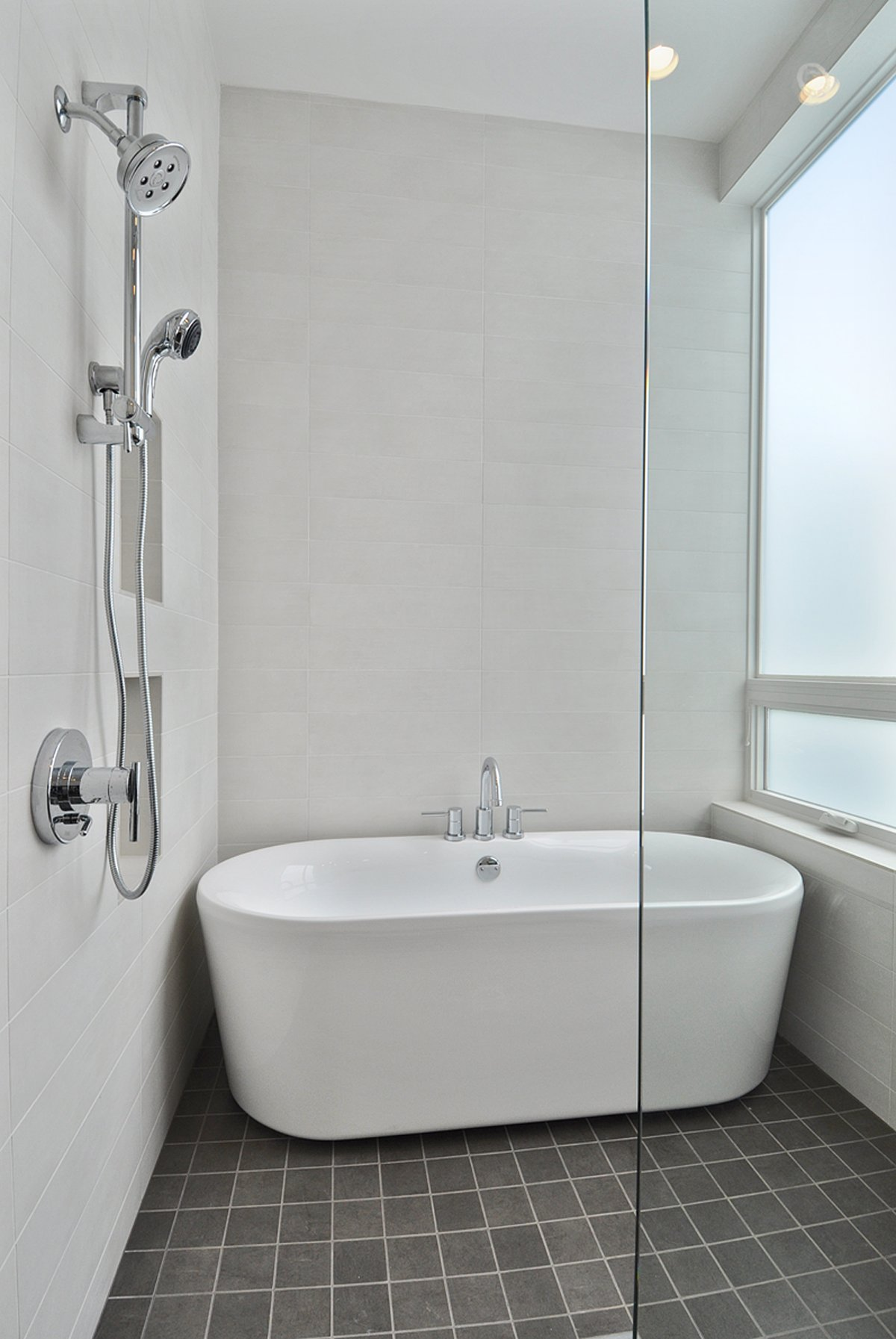 white small bathtubs with shower and glass door