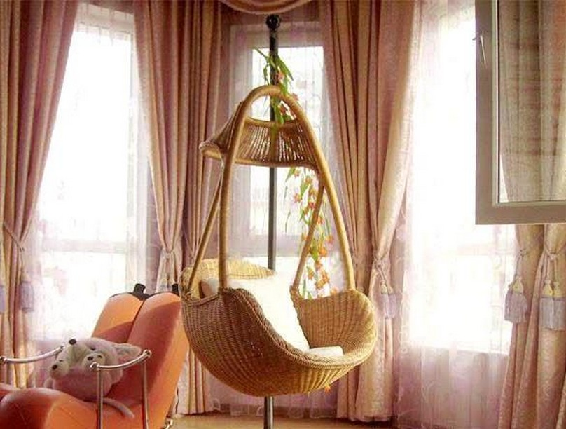 Wicker Chairs That Hang From The Ceiling With Large Curtains And Chair
