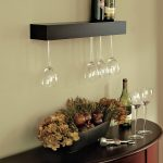Wine Shelf And Glass Wall Holder Near To Wine Table