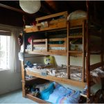Wooden Corner Quadruple Bunk Beds For Kids With Beams Ceiling And White Curtains