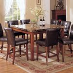 Wooden Granite Dining Table Set With Eight Awesome Chairs And Stylish Rug