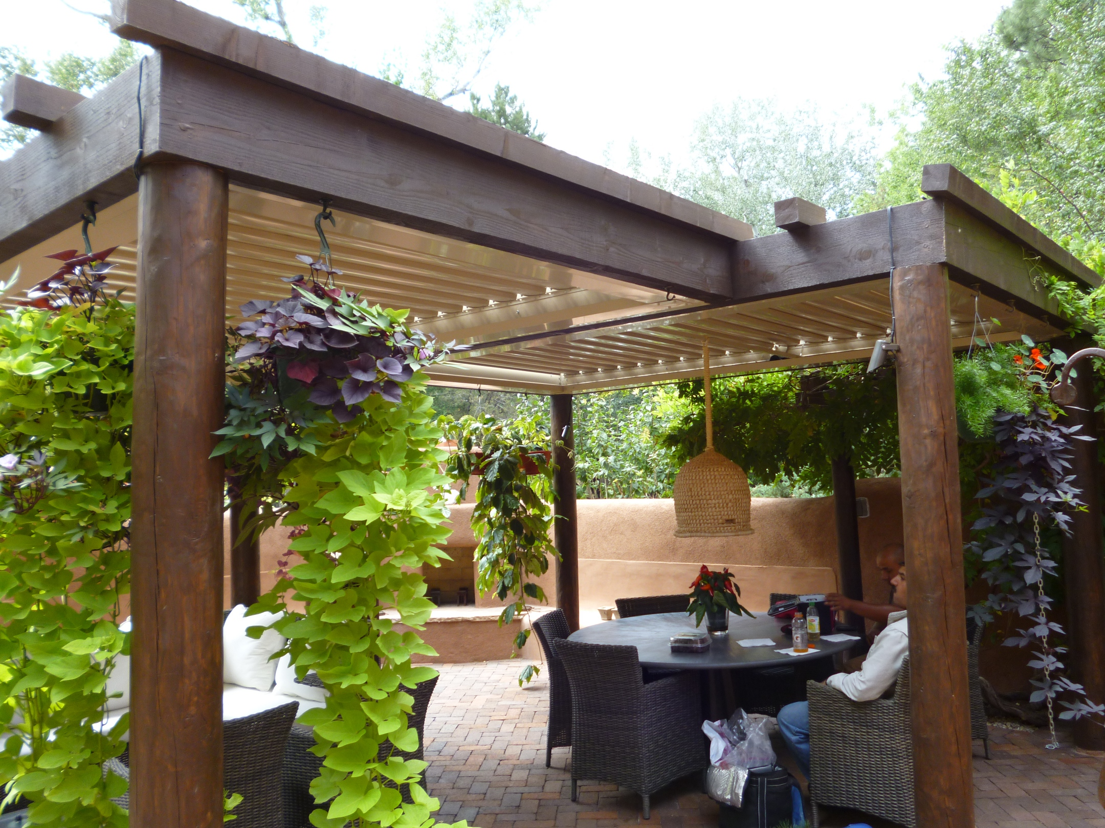 wood patio covers. Exellent Wood Wooden Patio Cover Design Decor With Hanging Plants And Grey Table Chair Set On Wood Covers