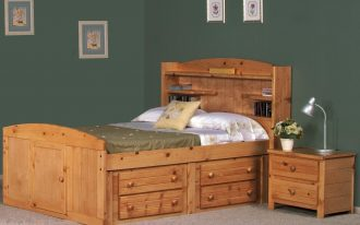 A captain bed frame with book rack on headboard a wooden bedside table with two units of pull out drawers