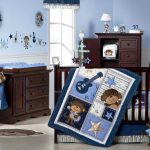 A nursery room decor theme with cute monkey pictures wood made baby crib wooden storage unit wooden baby changing desk with storage unit underneath
