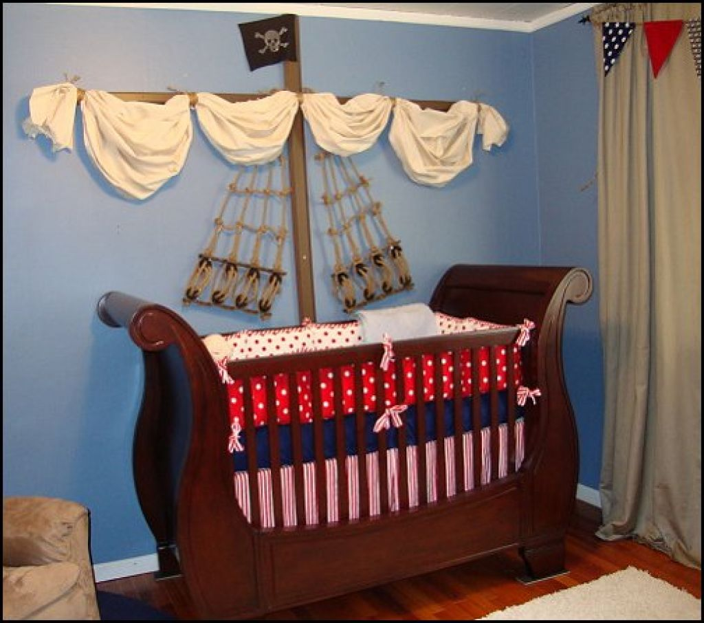 A Nursery Room Decorating Idea With Pirate Theme Unique Baby Crib Made Of Hardwood