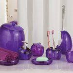 A package of purple glass bath accessories