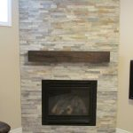 A reclaimed wood mantel as the accent of modern glass door fireplace