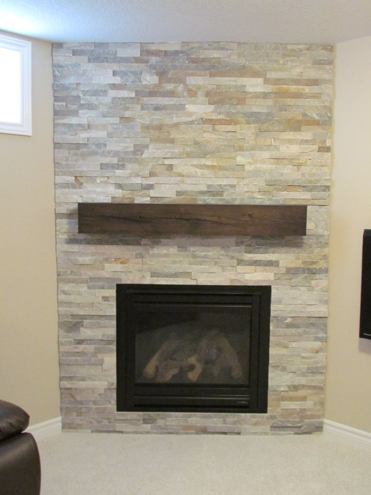 A reclaimed wood mantel as the accent of modern glass door fireplace - Reclaimed Wood Mantels For A Rustic Or Antique Fireplace Look