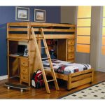 A twin size bunk over another twin size bunk with desk and stairs