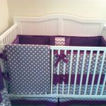 Bedding set with white and purple polka dots applied on gray as the background color
