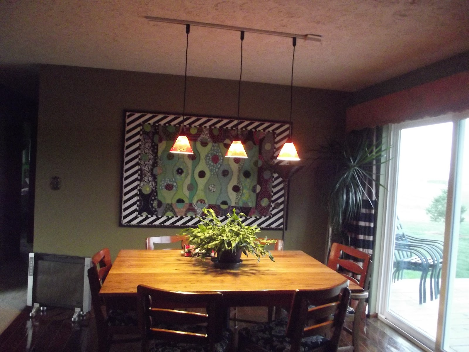 pendant lamp over dining table. modern dining roomwebber