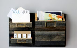 Cool shabby wooden mail organizer mounted on wall