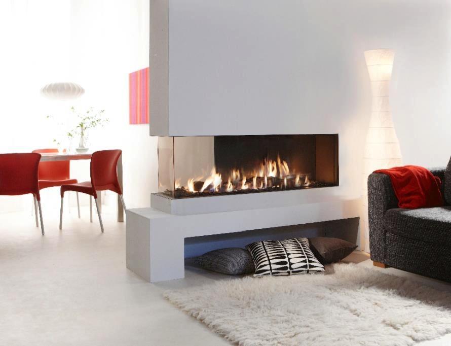 Frameless glass door gas fireplace idea for modern minimalist home fluffy white rug a couch a stunning floor lamp