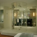 Frameless glass door standup shower idea in cylinder shape wall mounted showerhead