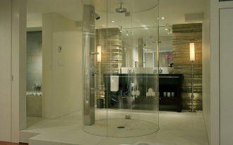 Frameless glass door standup shower idea in cylinder shape wall mounted showerhead