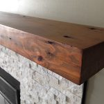 Hardwood mantel idea with deep brown finishing for a fireplace