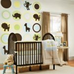 Jungle themed nursery room idea with black painted wood baby crib a white side table with table lamp