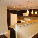 Kitchen Triple Track Lighting With Pendants And Marble Kitchen Island