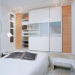 Large and white sliding closet door with semi transparent board at the center