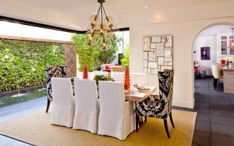 Mediterranean Dining Room With White Slipcovered Dining Chairs Unique Chandelier And Large Rug