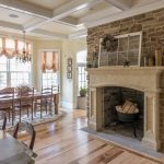Middle Stone Fire Places Between DIning Room And Living Room