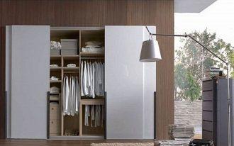 Minimalist sliding closet door in white modern floor lighting fixture small white interior rug