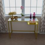 Modern console table with gold framed glass tabletop by IKEA