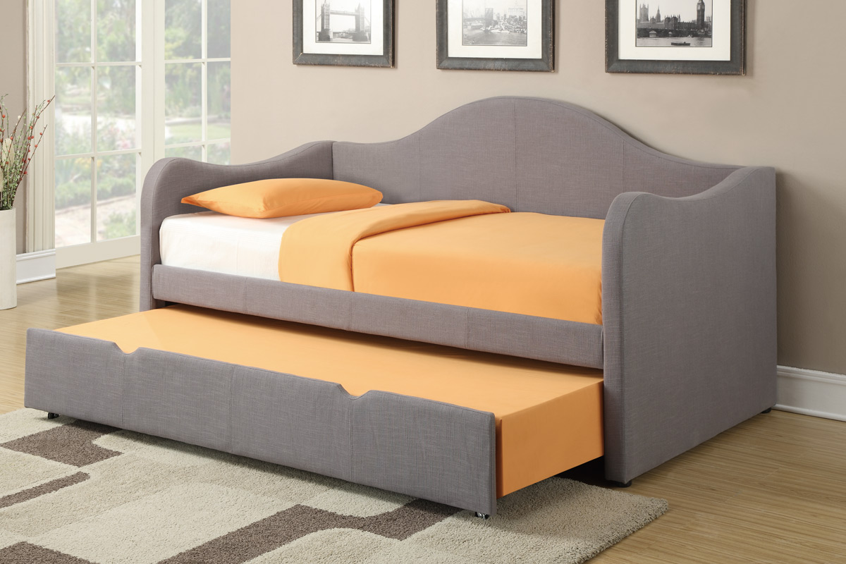 Modern grays daybed with white upholstery covered with bright orange sheet and additional trundle